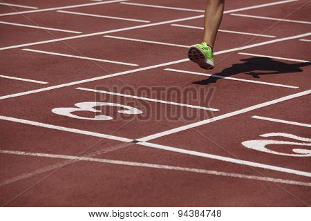 Detail Of A Male Athlete Leg Crossing The Finish Line