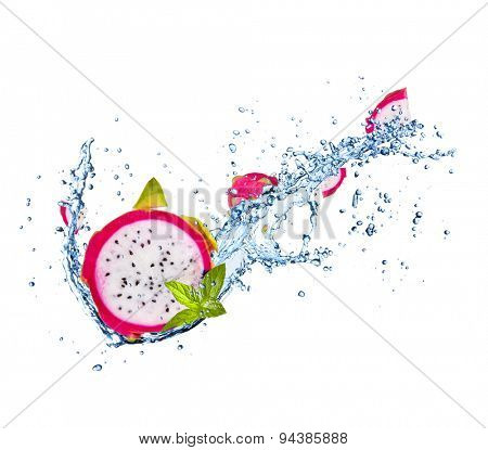 Fresh dragon fruit in water splash isolated on white background