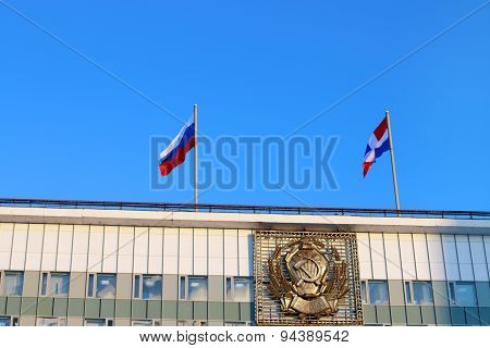 Russian Flag And Perm Territory In Roof Of Building With Emblem Of Ussr. Text On Emblem: Rsfsr, Prol