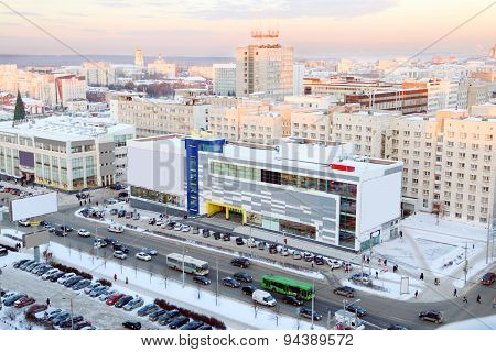 Shopping Center Next To Road And Parking In City In Winter Evening