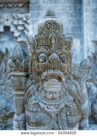 Stone sculpture on entrance door of Pura Padmasana Puja Mandala temple