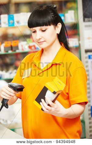 seller cashier with bar code scanner scanning lamp at store