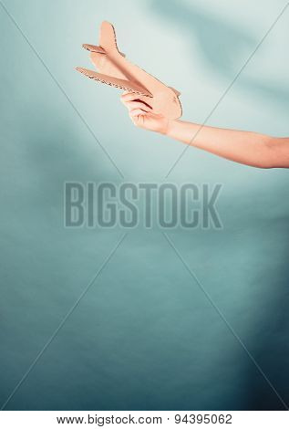 Woman Holding Airplane In Hand.