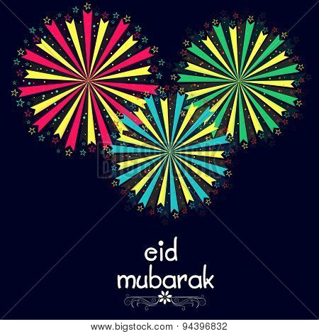 Beautiful greeting card decorated with colorful firecrackers on blue background for Muslim community festival, Eid Mubarak celebration.
