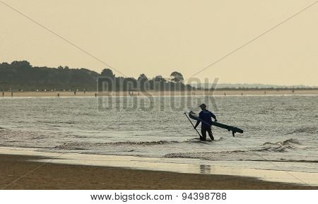 Paddle Boarder at Dawn