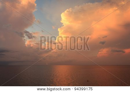Beautiful Sun Rise And Dramatic Sky With Lighting To The Small Platform In The Middle Of The Ocean.