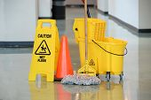 foto of slip hazard  - Caution sign with mop and bucket on office floor - JPG