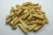 picture of potato chips  - Heap of fried potato chip sticks on white background - JPG