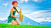 picture of saxophones  - Young saxophonist  - JPG