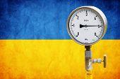 pic of air pressure gauge  - High pressure reading on gas wellhead isolated on flag Ukraine - JPG