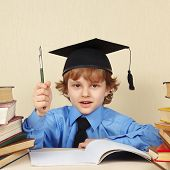 image of professor  - Little professor in academic hat with rarity pen among the old books - JPG