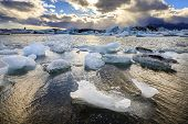 picture of iceberg  - Icebergs floating in Jokulsarlon Lagoon by the southern coast of Iceland - JPG