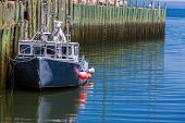 pic of lobster boat  - A lobster fishing boat tied up at the wharf in Hall - JPG