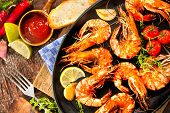 stock photo of tiger prawn  - Fried king prawns on iron pan - JPG