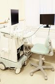image of ultrasound machine  - Interior of medical room with ultrasound diagnostic equipment - JPG