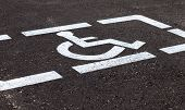pic of physically handicapped  - Parking places with handicapped or disabled signs and marking lines on asphalt - JPG