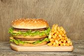 pic of hamburger-steak  - Hamburger and french fries on old wooden background - JPG