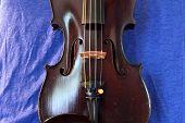 foto of violin  - Vintage violin against blue linen - JPG