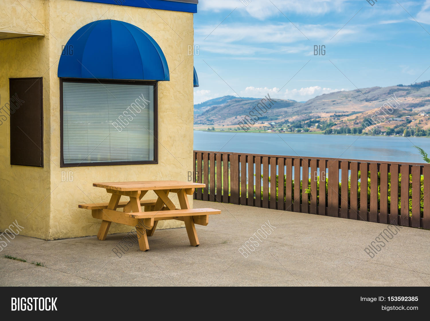 Cafe area with wooden table on Okanagan lake shore  Table and