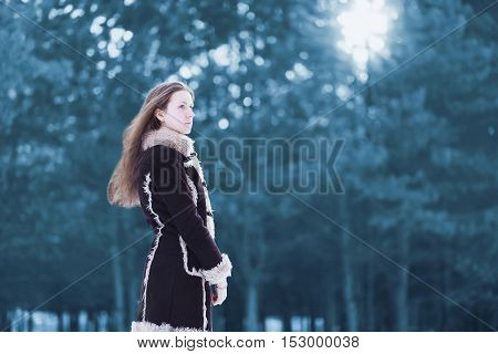 Silhouette Beautiful Young Woman Standing Profile And Looks Wearing A Brown Coat In Winter Cold Snow