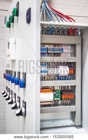 Automatic programming relay has control over electrical panel power lines located inside of the switch box.
