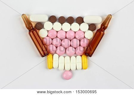 medicinal tablets ampules for injections on white background