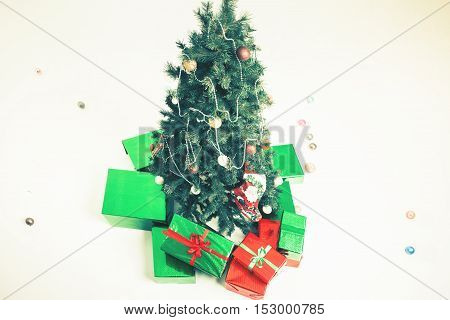Christmas tree with gifts at white background. Decorated Cristmas tree. Copy space.
