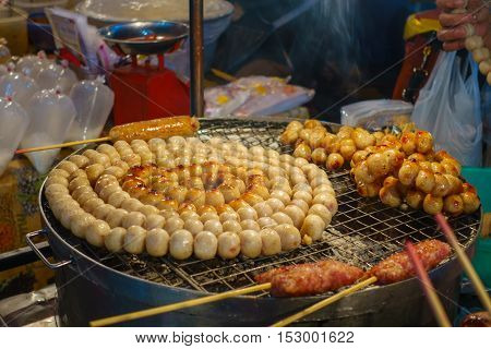 E-Saan Sausage the native food of Thailand sold on Warorot market Chiang Mai Thailand.