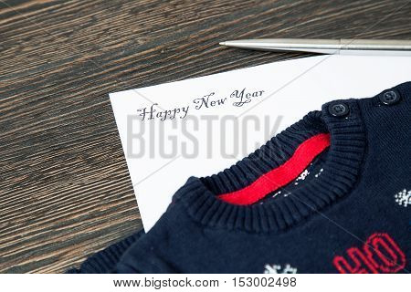Happy New Year 2017 written on paper and gift