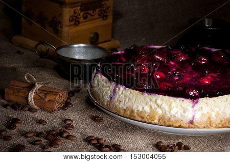 Homemade cheesecake with cherry jam light brush