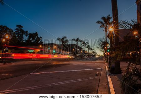 Editorial of streaking headlights going past Starbucks on Main Street in Ventura at dawn on October 22, 2016.
