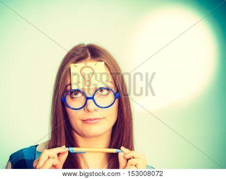 Woman Thinking Light Idea Bulb On Head