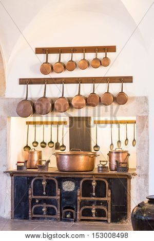 interior old kitchen with vintage kitchenware in palace