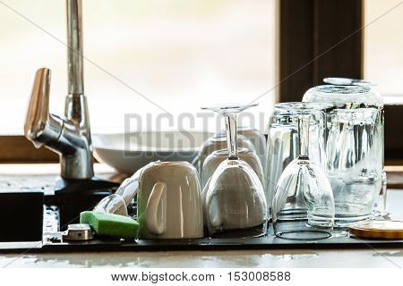 Washing Up. Kitchen Sink And Dishwares
