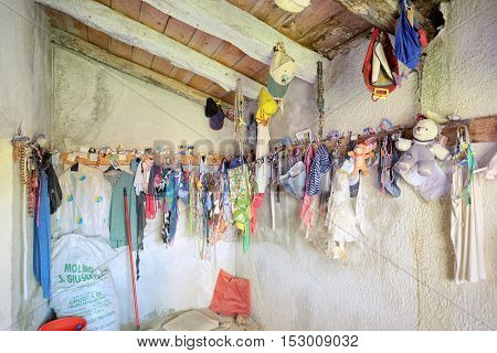 NEBRODI PARK, SICILY - OCTOBER 22, 2016: Ex-voto in chapel Three Virgins of Nebrodi Park. Ex-voto are votive offering to a saint or a divinity given in fulfillment of a vow