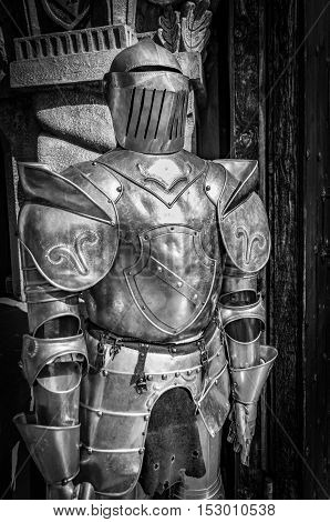 Medieval armor in front of the entrance to a castle.