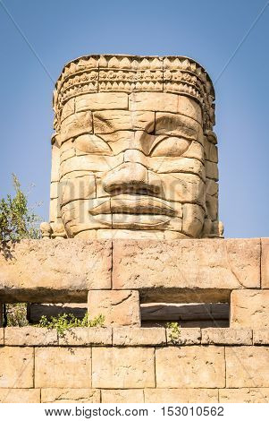 Stone face of a temple in the forest.