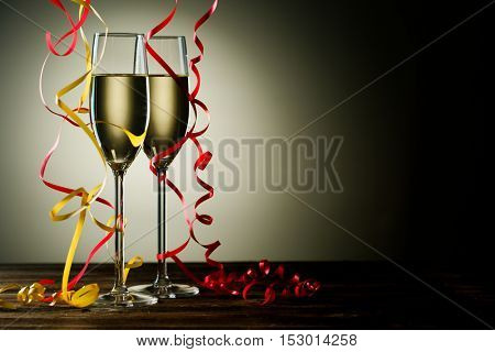 Two filled champagne glass with festive decoration