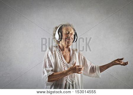 Grandmother wearing headphones
