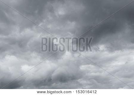 Gray sky rain. Thunderclouds over horizon dark gray.