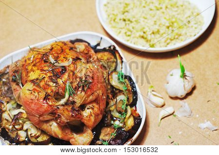 Thanksgiving turkey with eggplants garlic and rosemary on rustic wooden background
