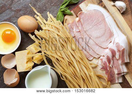 Pasta carbonara ingredients.  Top view on slate.