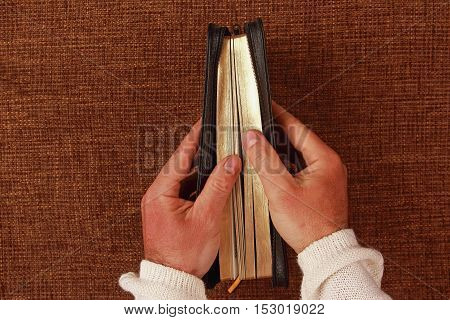 the half open bible in his hand