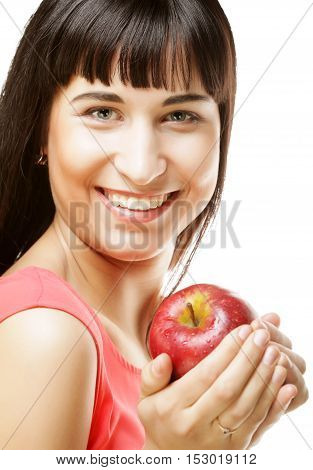 People, health and diet concept: beautiful brunette woman with red apple in hands