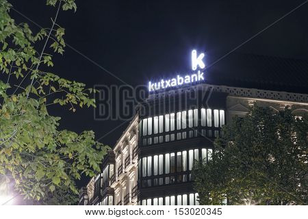 BILBAO, SPAIN - OCTOBER 24, 2016: Building exterior of the central headquarters of the spanish bank Kutxabank in the city of Bilbao at night.