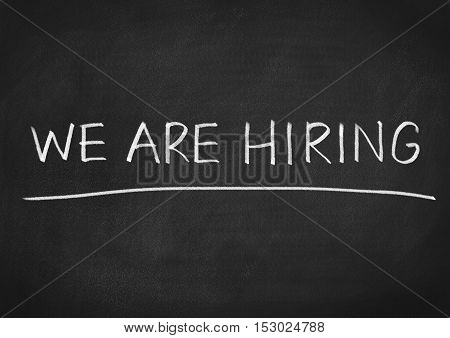 we are hiring recruitment concept text on blackboard background
