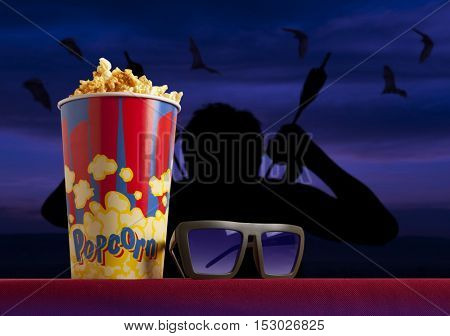 3d glasses and popcorn on red armchair cinema. Blockbuster concept