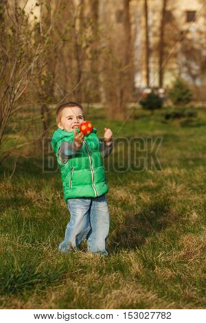 Boy playing with ball in the autumn park. Family time. The happiness of childhood. Outdoor Activities.
