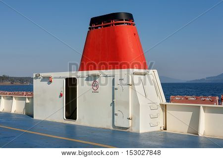 Detail of red exhaust stack and vehicle deck on car ferry