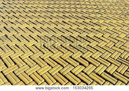 Yellow tiles the surface of the carriageway on Deribasovskaya Street in Odessa